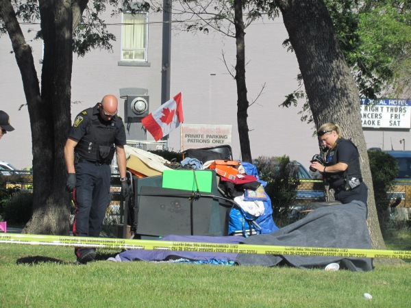 The Winnipeg police look for clues after the death of Gabriel Radford Coates at William Whyte Park on Wednesday morning. (Photo by Northern Plains Freelancer)