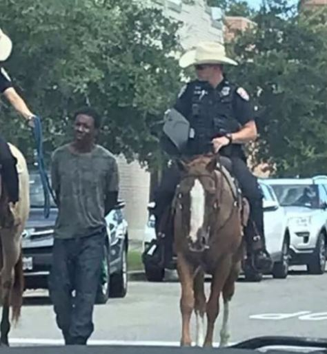 Photos emerged online over the weekend showing two white police officers on horseback leading a black man in handcuffs down a street with a rope.