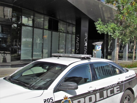 A Winnipeg police cruiser is parked outside an apartment block at 265 Portage Avenue where two people were stabbed Sunday morning. Photo: Northern Plains Freelancer.