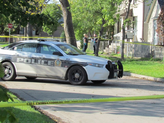 Winnipeg police investigate a homicide outside a house at the 600 block of Pritchard Avenue on Monday, October 7, 2019. Photo: Northern Plains Freelancer.