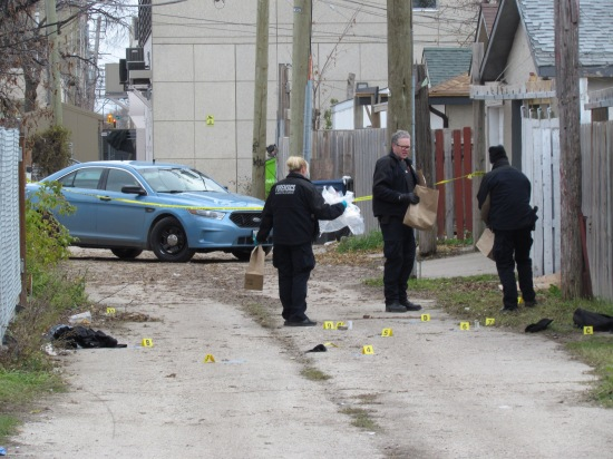 Winnipeg police investigate a double homicide in the back lane of Ross Avenue and Isabel Street on Sunday. Photo: Northern Plains Freelancer.