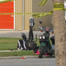 Police bomb technicians deploy a bomb-disposal robot to investigate a suspicious item.