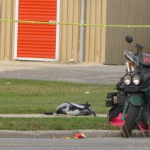 A bomb-disposal robot spilled out items from inside a backpack onto the sidewalk.