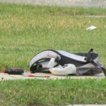 Items from inside a backpack lay on a sidewalk on Dufferin Avenue