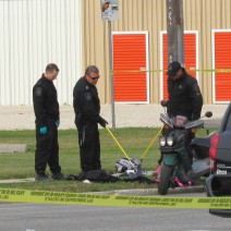 Bomb unit members comb through items from inside a backpack.