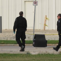 Bomb unit members leave after investigating a suspicious item.
