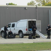 Police bomb unit pack up after investigating a suspicious item.