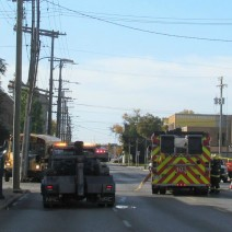 A tow truck and fire truck at the scene of a school bus accident on Logan Avenue.